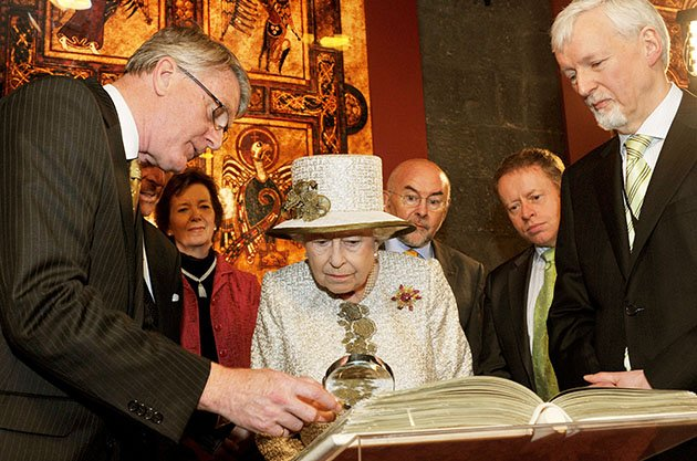 Queen Elizabeth II examines the Book of Kells on May 17, 2011. (John Stillwell/Getty Images)