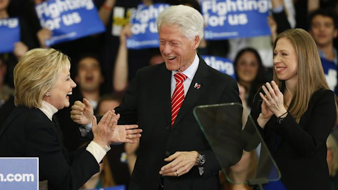 Democratic U.S. presidential candidate Hillary Clinton is joined by her daughter Chelsea and her husband President Clinton as she speaks to supporters at her final 2016 New Hampshire presidential primary night rally in Manchester