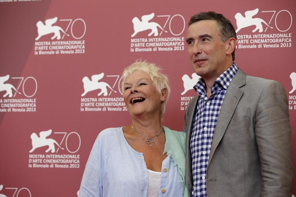 Actors Judi Dench and Steve Coogan poses for photographers during a photo call to promote the film Philomena at the 70th edition of the Venice Film Festival held from Aug. 28 through Sept. 7, in Venice, Italy, Saturday, Aug. 31, 2013. (AP Photo/Andrew Medichini)