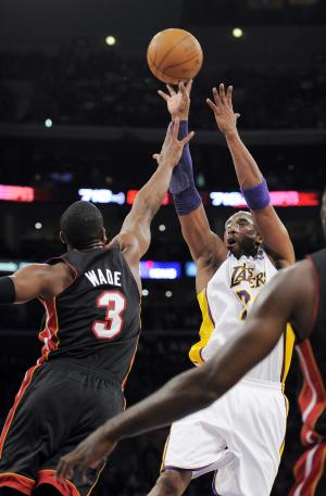 Los Angeles Lakers guard Kobe Bryant, right, shoots over Miami Heat guard Dwyane Wade (3) during the first half of their NBA basketball game, Sunday, March 4, 2012, in Los Angeles. (AP Photo/Mark J. Terrill)