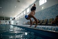Afghan amputee Malek Mohammad trains in a swimming pool in Kabul on April 13, 2012. The 18-year-old, whose legs were blown off by a Soviet landmine, dreams of swimming for Afghanistan in the London Paralympics