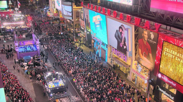 This image provided by EarthCam shows a New Year's Eve scene in Times Square on Broadway on Thursday, Dec. 31, 2015, in New York. New Year's Eve is us...