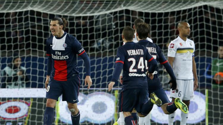 Paris St Germain's Ibrahimovic celebrates after scoring against FC Sochaux during their French Ligue 1 soccer match at the Parc des Princes Stadium in Paris