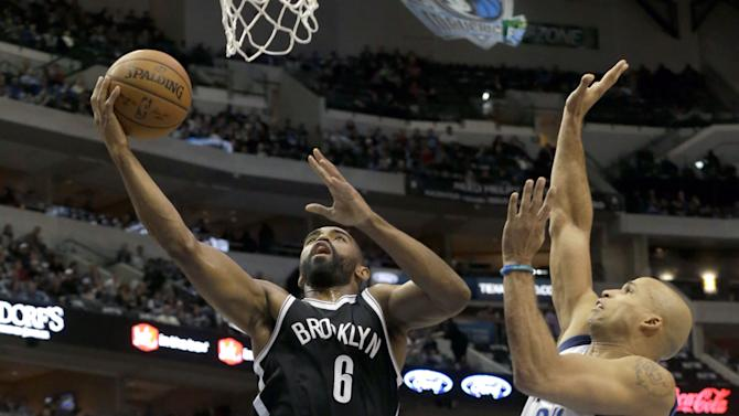 Brooklyn Nets guard Alan Anderson (6) shoots against Dallas Mavericks forward Richard Jefferson (24) during the first half of an NBA Basketball game Saturday, Feb. 28, 2015, in Dallas. (AP Photo/LM Otero)