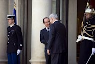 French President Francois Hollande (L) and Israel's Prime Minister Benjamin Netanyahu shake hands after a press conference at the Elysee Palace in Paris. Netanyahu is also due to meet Prime Minister Jean-Marc Ayrault and Foreign Minister Laurent Fabius