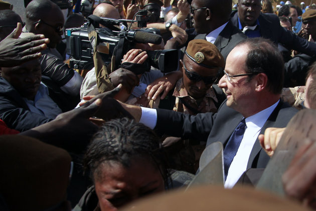 French President Francois Hollande greets well-wishers during his two-hour-long visit to Timbuktu, Mali, Saturday Feb. 2, 2013. (AP Photo/Jerome Delay)