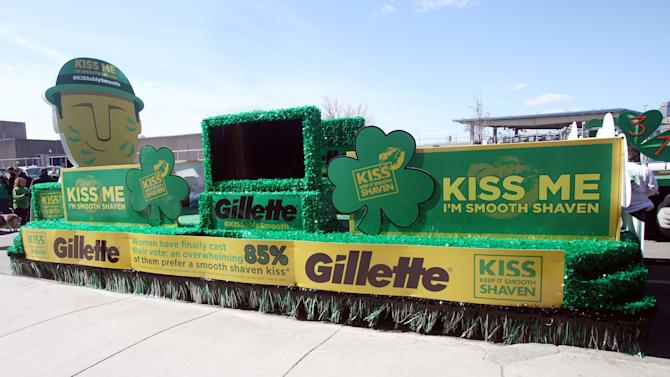 "IMAGE DISTRIBUTED FOR GILLETTE - The Gillette ""Kiss Me, I'm Smooth Shaven!"" float at the St. Patrick's Day Parade in Boston, reminding guys to K.I.S.S. - Keep It Smooth Shaven, on Sunday, March 17 2013. .  A recent study revealed that 85% of women prefer to kiss a man who's smooth shaven, and that two out of three women said men will have better luck with them if they are stubble-free. (Photo by Aynsley Floyd/Invision for Gillette/AP Images)"