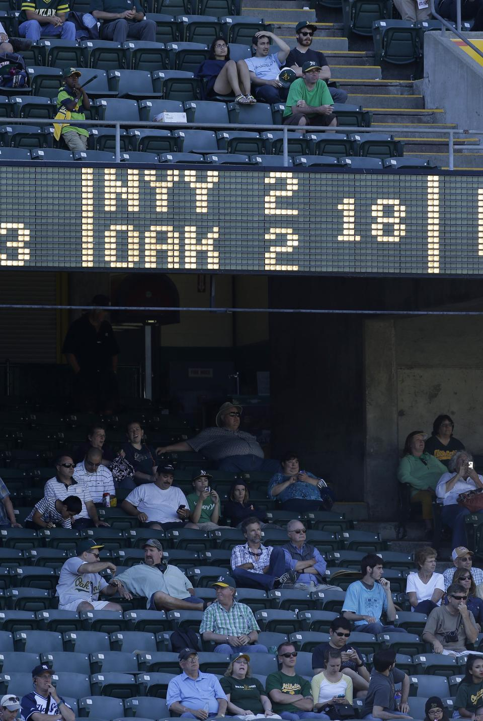 Fans watch from left field during the 18th inning of a baseball game between the Oakland Athletics and New York Yankees Thursday, June 13, 2013, in Oakland, Calif. Oakland won 3-2 in 18 innings (AP Photo/Eric Risberg)
