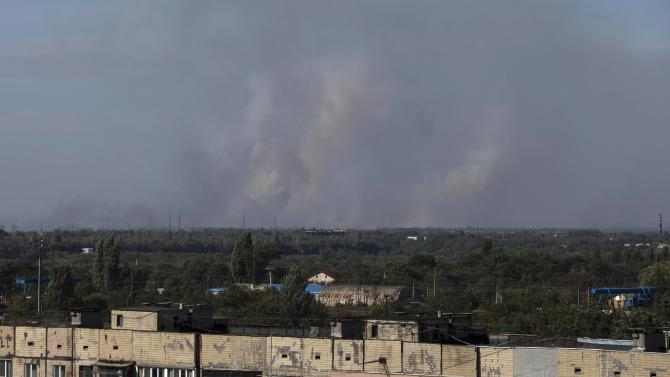 Smoke rises in the sky after shelling on the outskirts of Donetsk, eastern Ukraine