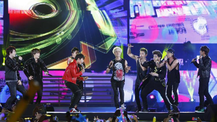 South Korean boy group Super Junior performs during the 27th Golden Disk Awards in Sepang, Malaysia, Tuesday, Jan. 15, 2013. (AP Photo/Lai Seng Sin)