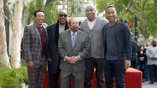 "Smokey Robinson, Stevie Wonder, Ken Ehrlich, LL Cool J and John Legend pose for photographs at a ceremony where Ehrlich receives a star on the ""Hollywood Walk of Fame"" in Los Angeles"