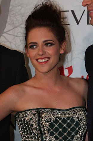 Kristen Stewart cracked a normally elusive smile.