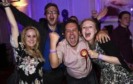 "Supporters from the ""No"" Campaign celebrate at the Better Together Campaign headquarters in Glasgow, Scotland"