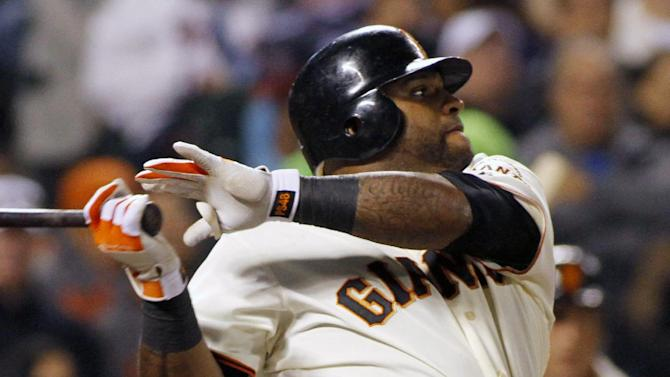 San Francisco Giants' Pablo Sandoval hits an RBI single against the Atlanta Braves during the third inning of a baseball game in San Francisco, Thursday, Aug. 23, 2012. (AP Photo/George Nikitin)