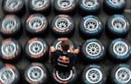 A member of staff works on tyres at the Formula One paddock in Singapore on September 22, 2011 ahead of the Formula One Singapore Grand Prix. Thailand's tourism and sports minister Monday told AFP he was confident the country would host its first Formula One race in 2014, with talks already at an advanced stage