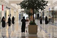 Women walk through a shopping mall in the Saudi capital of Riyadh in 2008. A YouTube video of a Saudi woman defying orders by the notorious religious police to leave a mall because she is wearing nail polish has gone viral, attracting more than a million hits in just five days