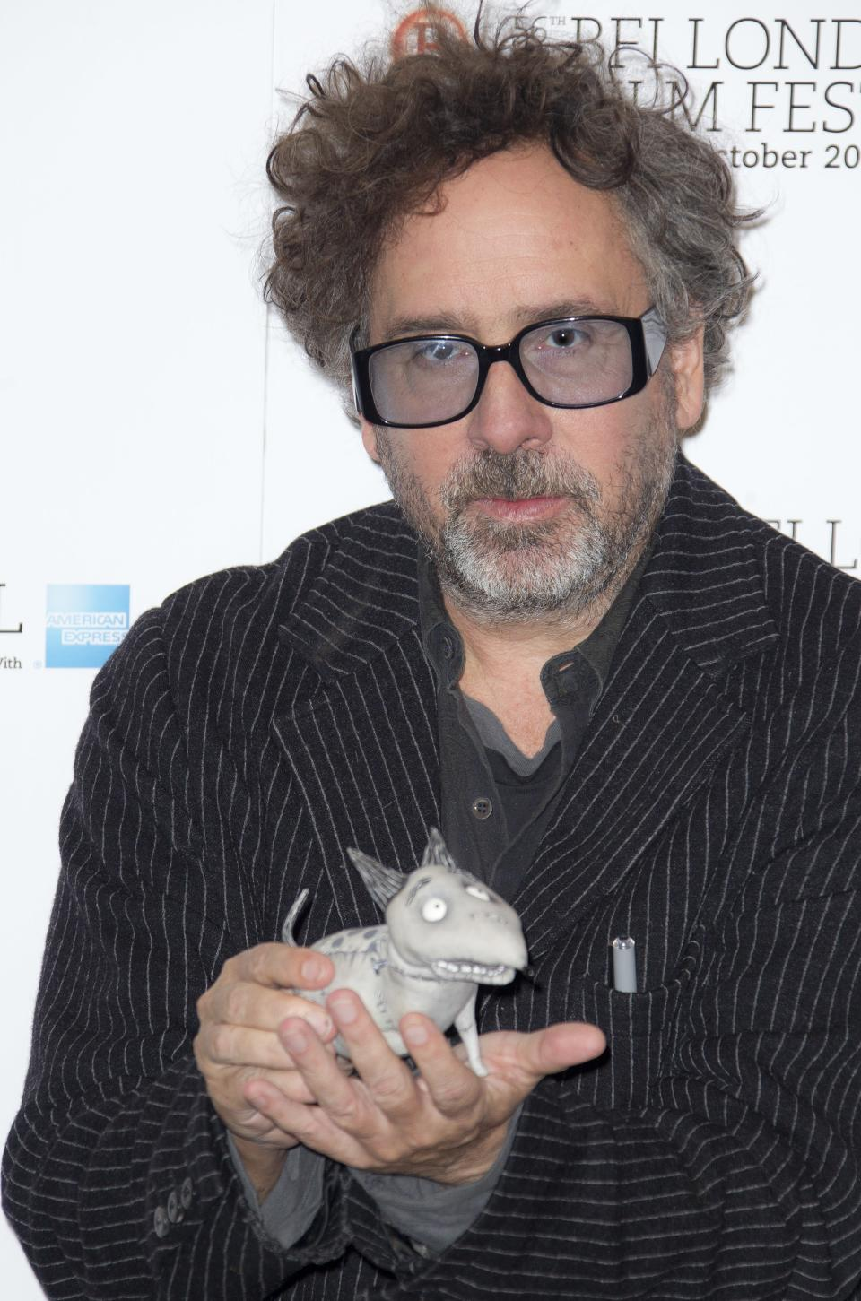 "Director Tim Burton holds a ""sparky"" toy seen at a photocall for his film  ""Frankenweenie""  during the London Film Festival at The Odeon, Leicester Square on Wednesday, October 10, 2012 in London. (Photo by Joel Ryan/Invision/AP)"