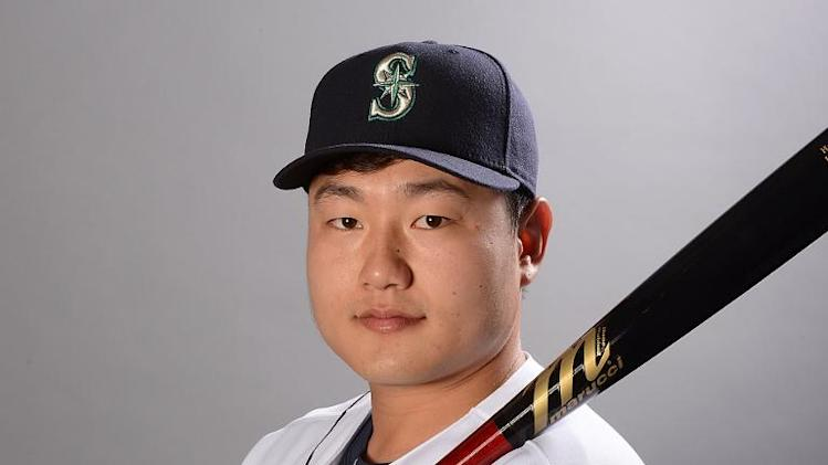 Choi Ji-Man of the Seattle Mariners poses for a portrait during spring training photo day on February 20, 2014 in Peoria, Arizona