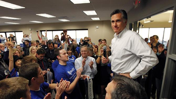 FILE - In this Feb. 3, 2012, file photo Republican presidential candidate, former Massachusetts Gov. Mitt Romney, greets campaign volunteers at a phone banking center in Las Vegas, Nev. Romney's campaign notes that the contest this time looks very different from 2008, despite the Democrats' persistent registration edge in the state. With Nevada boasting the highest unemployment rate in the nation, polls show the Republican candidate remains within striking distance. (AP Photo/Gerald Herbert, File)