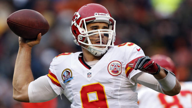 Kansas City Chiefs quarterback Brady Quinn passes against the Cleveland Browns in the third quarter of an NFL football game in Cleveland, Sunday, Dec. 9, 2012. (AP Photo/Rick Osentoski)