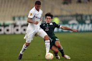 Lazaros Christodoulopoulos (R) of Panathinaikos tackles Tottenham's Kyle Walker during the group stage Europa League football game between Panathinaikos and Tottenham at the Olympic stadium in Athens. The match ended in a 1-1 draw