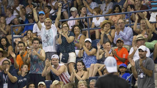 Fans react as Hewitt of Australia plays compatriot Tomic during their second round match at the U.S. Open Championships tennis tournament in New York