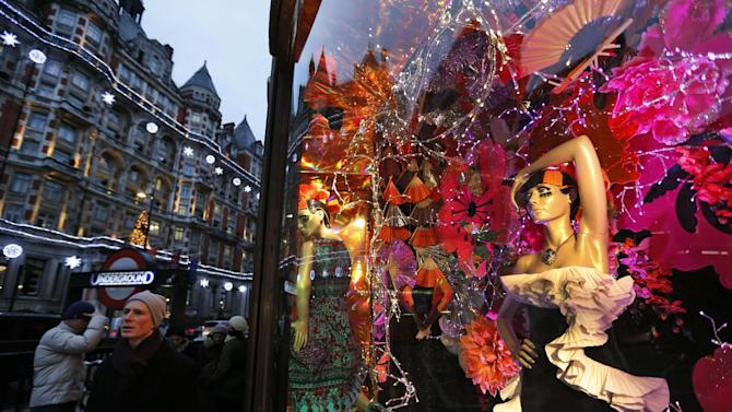 "People walk past a decorated front window of a department store in central London, Thursday, Dec. 20, 2012. Across Europe, holiday ""shoppers"" this season are doing more browsing than buying. In Rome, some shop for their Christmas presents in sales throughout the year. In Paris, refurbished second-hand toys are attracting buyers. Retailers remain hopeful for a last-minute burst of Christmas consumerism, and some governments are encouraging it by allowing stores to open on Sunday. But with economies across the region slowing and unemployment soaring, analysts say holiday spending in Europe is bound to disappoint for the fourth year in a row. (AP Photo/Lefteris Pitarakis)"