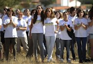 "Members of PACMA hold spears during a protest in the Spanish town of Tordesillas, as they demonstrated against the ""Toro de la Vega"" festival"