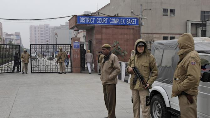 Indian police officers stand outside the district court where five men accused in a gang rape were brought to appear in New Delhi, India, Monday, Jan. 7, 2013. The men, who were set to appear in court Monday, are accused of the Dec. 16 gang rape on a woman, who later died of her injuries, that has caused outrage across India, sparking protests and demands for tough new rape laws. (AP Photo/Manish Swarup)