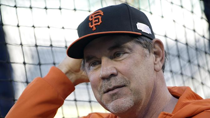 San Francisco Giants manager Bruce Bochy watches during baseball practice Monday, Oct. 20, 2014, in Kansas City, Mo. The Kansas City Royals will host the Giants in Game 1 of the World Series on Oct. 21. (AP Photo/David J. Phillip)