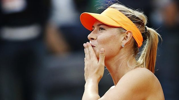 Maria Sharapova of Russia blows a kiss to spectators after defeating Garbine Muguruza of Spain (Reuters)