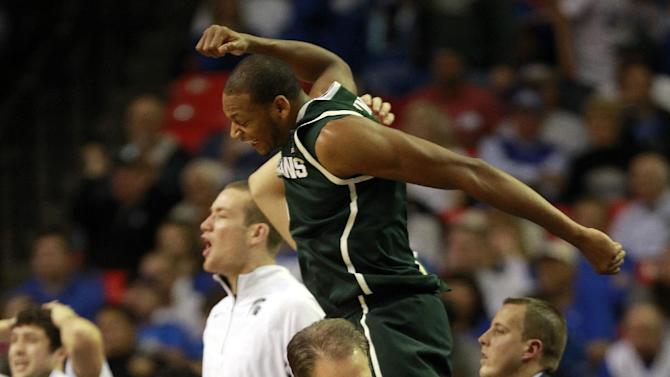Michigan State coach Tom Izzo reacts along with guard Denzel Valentine, rear, at the end of a 67-64 win over Kansas during the second half of an NCAA college basketball game at the Georgia Dome in Atlanta Tuesday, Nov. 13, 2012. (AP Photo/John Bazemore)