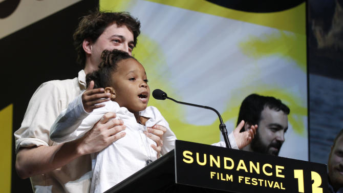 "FILE - In this Jan. 28, 2012 file photo, Director Benh Zeitlin, left, holds up actress Quvenzhane Wallis as they accept the Grand Jury Prize U.S. Dramatic award for the film ""Beasts of the Southern Wild"" during the 2012 Sundance Film Festival Awards Ceremony in Park City, Utah. Last year's top Sundance prize winner, ""Beasts of the Southern Wild,"" picked up four Oscar nominations, including best picture, director for first-time filmmaker Benh Zeitlin and actress for 9-year-old Quvenzhane Wallis, who had never acted before. (AP Photo/Danny Moloshok, File)"