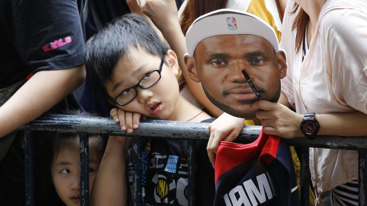 Children wait to see NBA basketball player LeBron James of the U.S. team Cleveland Cavaliers at a promotional event in Hong Kong