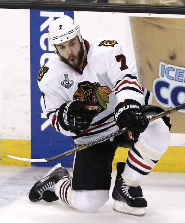 Chicago Blackhawks' Brent Seabrook celebrates after scoring the game-winning goal against the Boston Bruins during overtime in Game 4 of their NHL Stanley Cup Finals hockey series in Boston