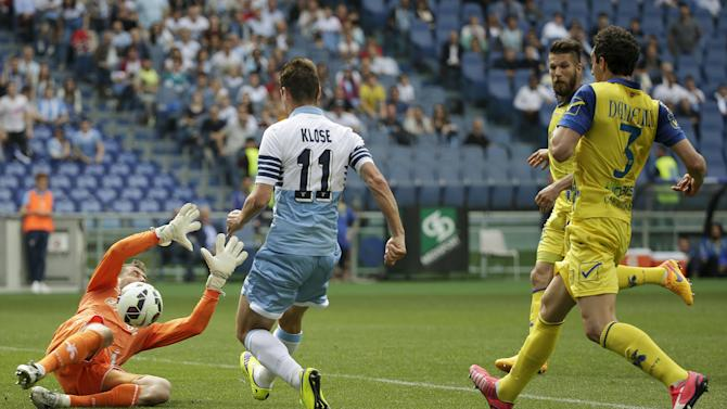 Lazio's Klose scores against Chievo Verona during their Serie A soccer match at the Olympic stadium in Rome
