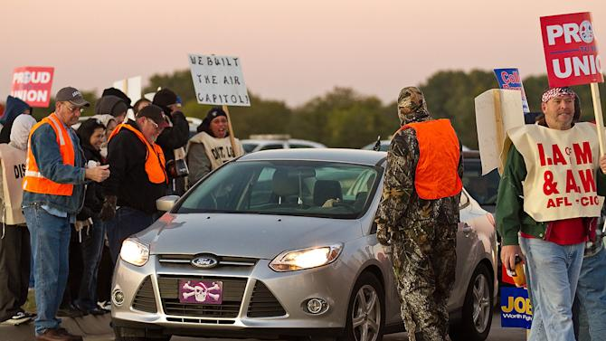 Machinist Union members picket Monday morning, Oct. 8, 2012, onTyler road outside the entrance to the Bombardier Learjet factory in west Wichita, Kan. In a vote Saturday, nearly 80 percent of Bombardier's Machinist union members voted to strike. (AP Photo/The Wichita Eagle, Mike Hutmacher)   LOCAL TV OUT; MAGS OUT; LOCAL RADIO OUT; LOCAL INTERNET OUT