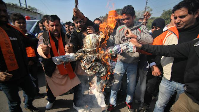 Activists of the right winged Hindu nationalist Vishwa Hindu Parishad, or World Hindu Council, shout slogans and burn an effigy representing Pakistan during a protest in Jammu, India, Thursday, Jan. 10, 2013. India has formally complained about an attack on an Indian army patrol in the disputed Himalayan region of Kashmir that killed two soldiers and left their bodies mutilated. India says Pakistani troops crossed the cease-fire line Tuesday and attacked Indian soldiers patrolling in the Mendhar region before retreating. (AP Photo/Channi Anand)