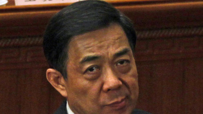 FILE - In this March 9, 2012 file photo, Chongqing party secretary Bo Xilai reacts during a plenary session of the National People's Congress held in Beijing, China. China's tumultuous, bizarre year in politics appears headed for a home stretch, with leading members of the ruling Communist Party convening to finalize a list of new leaders and decide the fate of a disgraced colleague. Disgraced Politburo member Bo has been the focal point of much of the tumult, which has featured a murder, corruption, two high-profile trials and a deadly car crash, all of which exposed bare-knuckled infighting among a leadership that prefers secrecy. (AP Photo/Ng Han Guan, File)