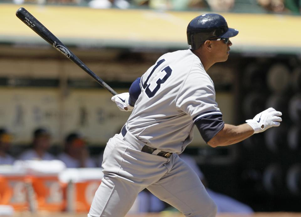 New York Yankees' Alex Rodriguez hits a two-run double off Oakland Athletics starting pitcher Bartolo Colon during the third inning of their baseball game Sunday, July 22, 2012 in Oakland, Calif.  (AP Photo/Eric Risberg)