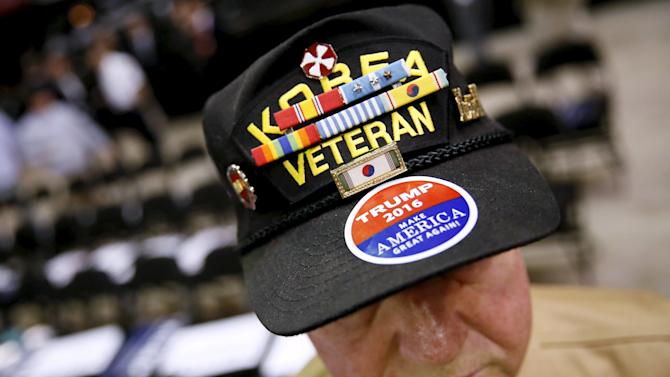 A veteran of both the Korean and the Vietnam War, C.J. Dauzt wears a sticker in support of Republican U.S. presidential candidate Donald Trump before a rally in Baton Rouge, Louisiana