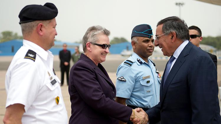 U.S. Secretary of Defense Leon Panetta, right, shakes hands with U.S. Ambassador to India Nancy Powell upon his arrival in New Delhi, India, Tuesday, June 5, 2012. (AP Photo/Jim Watson, Pool)