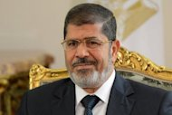 Egypt's new Islamist president, Mohamed Morsi (pictured on September 16), has urged the United States to change its approach to the Arab world to be able to repair relations and revitalize an alliance with Egypt.