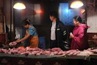 Shoppers buy pork at a market in Hefei, China's Anhui province. China's industrial output growth weakened in August to its slowest pace in more than three years, official figures showed, confirming a deepening slowdown in the world's second-biggest economy