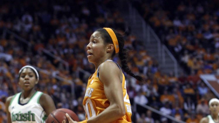 Tennessee center Isabelle Harrison (20) drives for a shot in the first half of an NCAA college basketball game against Notre Dame on Monday, Jan. 28, 2013, in Knoxville, Tenn. Harrison was injured on the play. (AP Photo/Wade Payne)