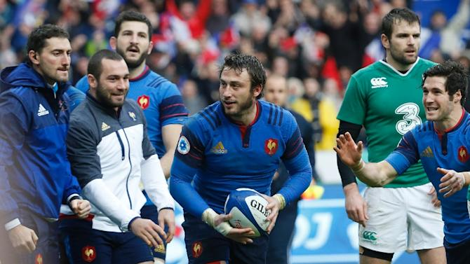 Maxime Medard (centre) celebrates after scoring the only try of the Six Nations match between France and Ireland at Stade de France, on February 13, 2016
