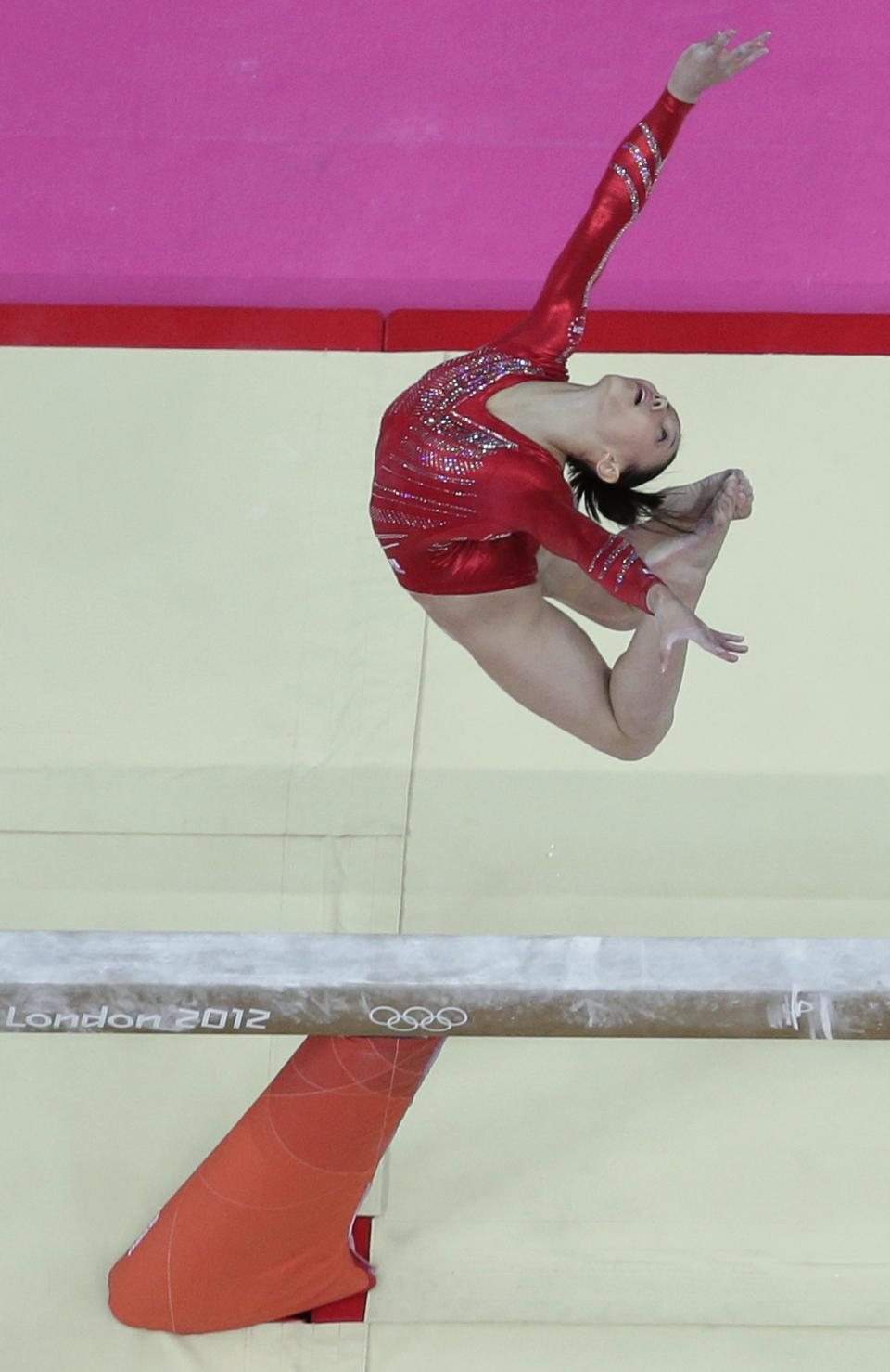 U.S. gymnast Kyla Ross performs on the balance beam during the Artistic Gymnastic women's team final at the 2012 Summer Olympics, Tuesday, July 31, 2012, in London. (AP Photo/Julie Jacobson)