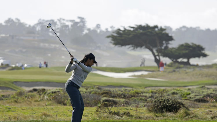 Former Secretary of State Condoleezza Rice hits from the 13th tee of the Monterey Peninsula Country Club Shore Course during the second round of the AT&T Pebble Beach Pro-Am golf tournament  Friday, Feb. 8, 2013 in Pebble Beach, Calif. (AP Photo/Eric Risberg)