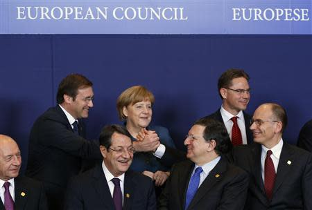 EU leaders take part in family photo during a European Union leaders summit at the EU council headquarters in Brussels