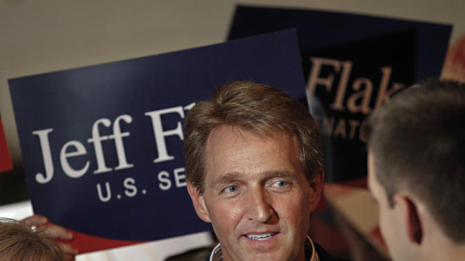 FILE - In this Aug. 28, 2012, file photo Arizona Republican Senate candidate and current U.S. Rep. Jeff Flake, R-Ariz., speaks at a primary election night party at his home in Mesa, Ariz. Flake's first ad after his primary win pointed out that his opponent, former U.S. surgeon general Richard Carmona, was personally recruited by the president to run as a Democrat. Flake opposes the president's health insurance overhaul; Carmona supports it.  (AP Photo/Matt York, File)
